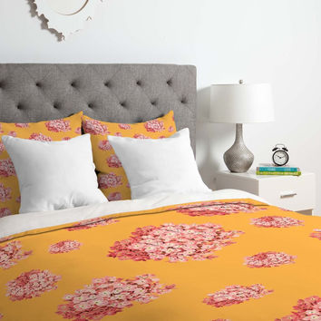 Pink Hydrangeas on Orange Duvet