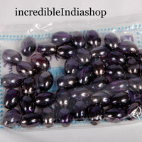 beautiful beads glassy finishing beads for multipurpose making of art & craft  things egg shaped 44 beads about 100 gms for making any art .