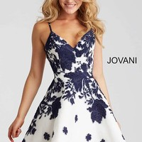 Ivory and navy print embellished spaghetti straps open back short dress.