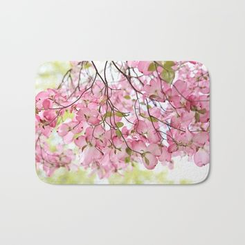 pink dogwoods Bath Mat by Sylvia Cook Photography