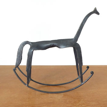 Brutalist forged iron rocking horse sculpture with long thin neck