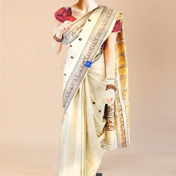 the khaadi tussar silk saree in rich cream with maroon accents and heavy gold print