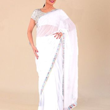 the pure white Georgette saree with thin embroidery