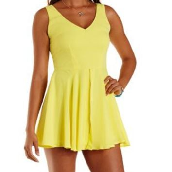 Yellow Front Slit Chiffon Skort Romper by Charlotte Russe