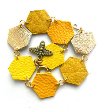 Honey bee bracelet, colourful leather spring bracelet in yellow and gold geometric hexagons