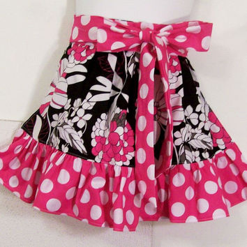 Girls Pink dot and black print ruffled half apron.