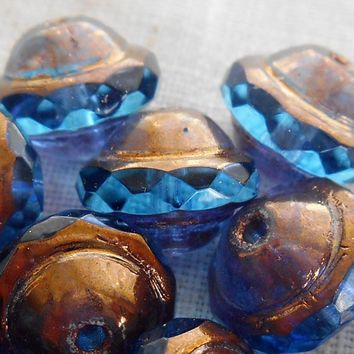 Fifteen transparent capri blue Czech glass faceted saturn or saucer bead with a bronze finish, 8mm x 10mm, C4801
