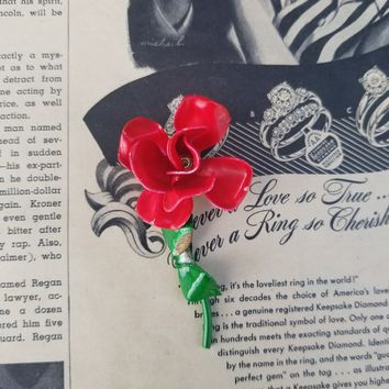 Red rose with green leaf and stem vintage tin brooch