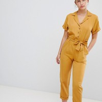 Pull&Bear button through jumpsuit in mustard at asos.com