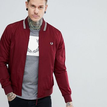 Fred Perry Tipped Bomber Jacket In Burgundy at asos.com