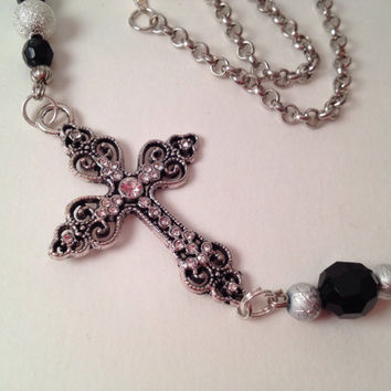 Off center Cross pendant with black and silver beads, statement, bib style