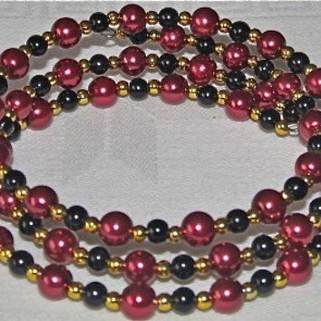 OOAK Cranberry Glass Beads with Black Beads on a Memory Bracelet with Gold-tone Accents
