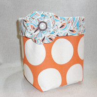 Orange Polka Dot Fabric Basket With Multi Colored Liner and Detachable Fabric Flower Pin