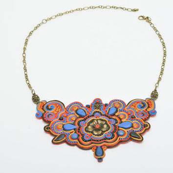 Handmade massive metal and polymer clay necklace with flower ornament in soutach