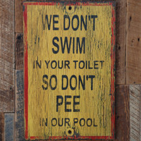 pool sign made from reclaimed plywood