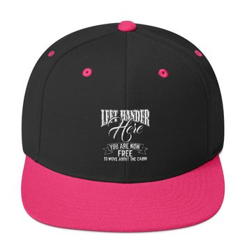 Left Hander Here You are now free to move about the cabin Snapback Hat