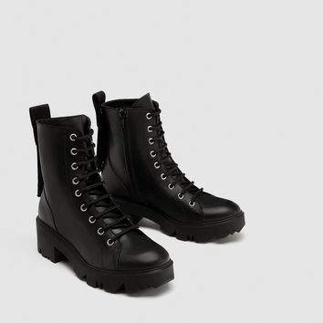 FLAT LEATHER ANKLE BOOTS WITH SLOGAN DETAILS