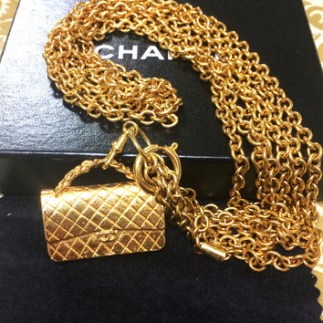 Vintage CHANEL golden double chain necklace with classic 2.55 bag charm, pendant top.