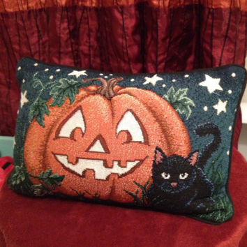 Sweet pumpkin smile and cat pillow is the perfect accessory for the season!
