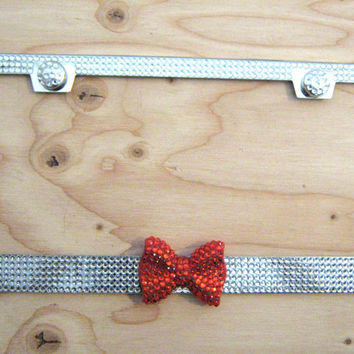 Clear Color Bling Rhinestone License Plate Frame w/ Red Bow on Middle and 2 Caps