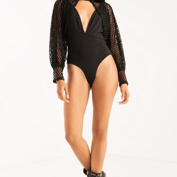 AKIRA Long Net Sleeve Plunging Crisscross Backless Bodysuit in Black