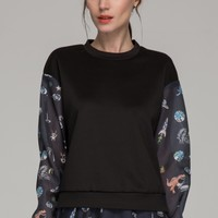 Top with contrast sleeves in cartoon print