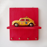 Yellow bug car on red shelf, collectible VW hippie bug car key organiser wooden shelf organiser, hippie bug car diorama & key holder