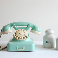 Aqua mint green vintage rotary telephone.