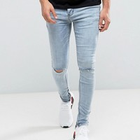 Sixth June Super Skinny Jeans In Lightwash Blue With Knee Rips at asos.com