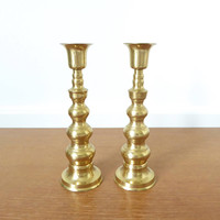 Two brass stacked ball candlesticks made in Japan, seven inches high