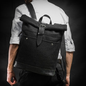 Roll top backpack made of black military overcoat fabric and leather by Kruk Garage Black wool felt backpack Overcoat collection