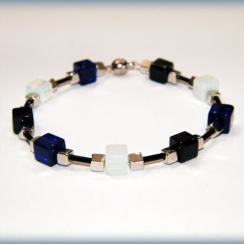 The Magpie bracelet .. Cobalt Blue, Opalite and Black glass bead bracelet with a magnetic clasp