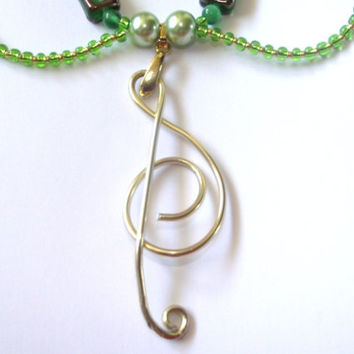 music note necklace treble clef green and gold