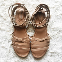 An Ankle Wrap Sandal in Nude
