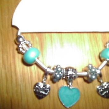 WOMAN'S TEAL THREE HEART CHARM BRACELET WITH BEADS