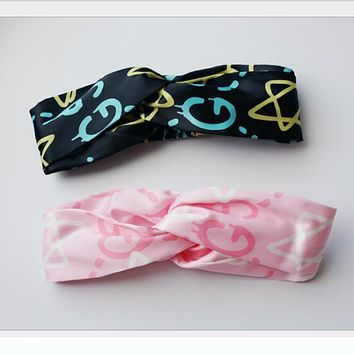 GUCCI European and American jewelry new graffiti stars pink silk satin cross headband