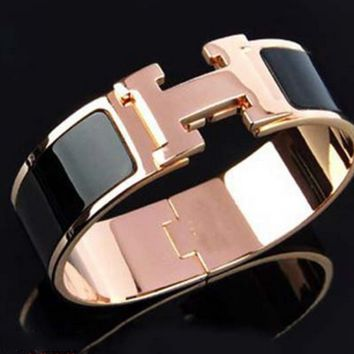 Hermes rose gold bracelet with two lovers swiveling kelly bracelet