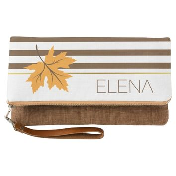 Maple leaf and brown and white stripes modern fall clutch
