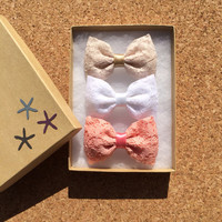 Beautiful vintage coral, white, and cream lace hair bows from Seaside Sparrow. Our vintage coral is limited.