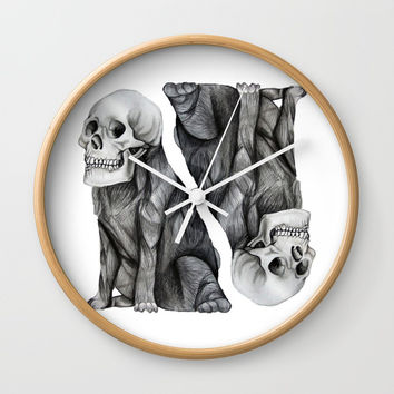 skullpug // A brutal pug wearing a human skull made in pencil Wall Clock by Camila Quintana S