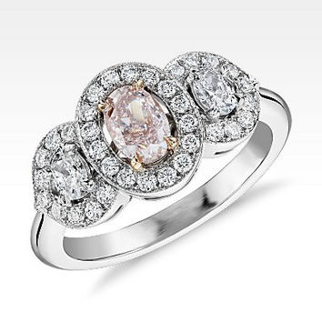 Fancy Light Pink Three Stone Diamond Halo Ring in Platinum and 18k Rose Gold (0.52 ct. centre)