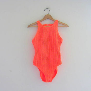 vintage 80s neon orange swimsuit. bathing suit with cut outs