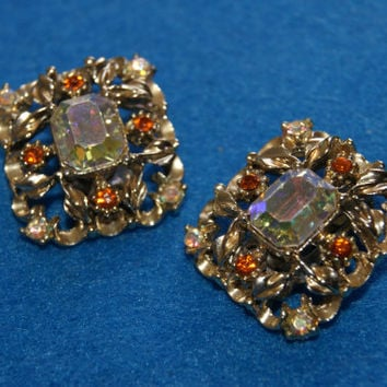 Vintage 1950s CORO Clip On Earrings With Aurora Borealis Center Stones With Multi Colored Rhinestone And Gold Tone Trim