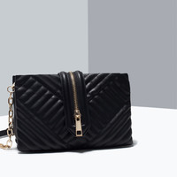 Zipped quilted messenger bag