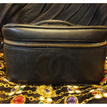 Vintage CHANEL caviarskin cosmetic and toiletary black purse. Very chic vanity purse from Chanel back in the era.
