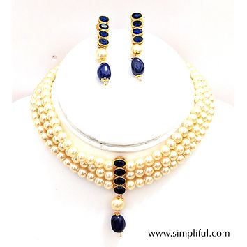 Faux pearl triple stranded collar necklace and Earring set