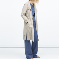 Draped trenchcoat