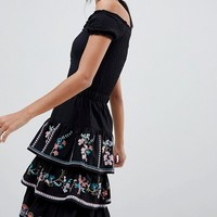 ASOS DESIGN tiered mini sun skirt with embroidery at asos.com