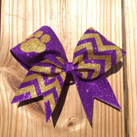 purple an gold paw print bow