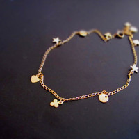 Gold Bracelet with 4 different shapes of charms Star by FalseAngel